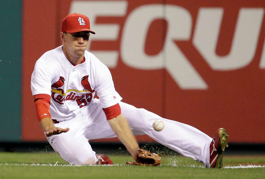 Cardinals right fielder Stephen Piscotty can't catch an RBI double by Kansas City Royals' Alcides Escobar during the 12th inning Wednesday night at Busch Stadium. Photo: Associated Press