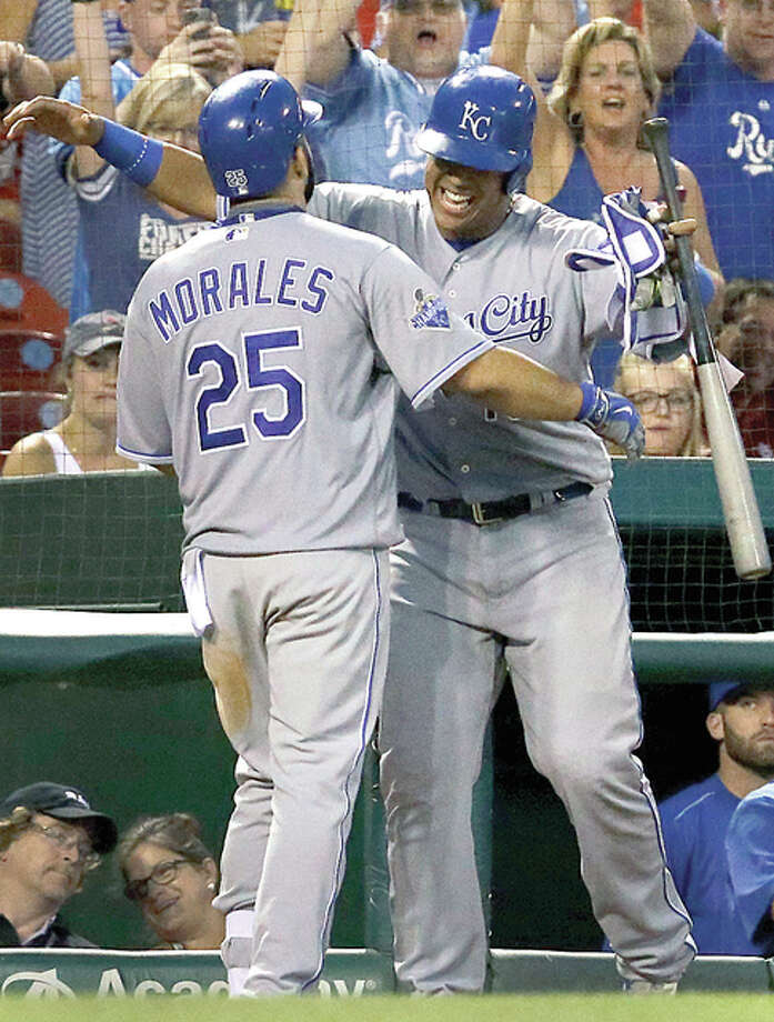 Kansas City's Kendrys Morales, left, gets a hug from Salvador Perez after hitting a solo home run during the eighth inning of a baseball game against the Cardinals Thursday in St. Louis. Photo: Jeff Roberson | AP Photo