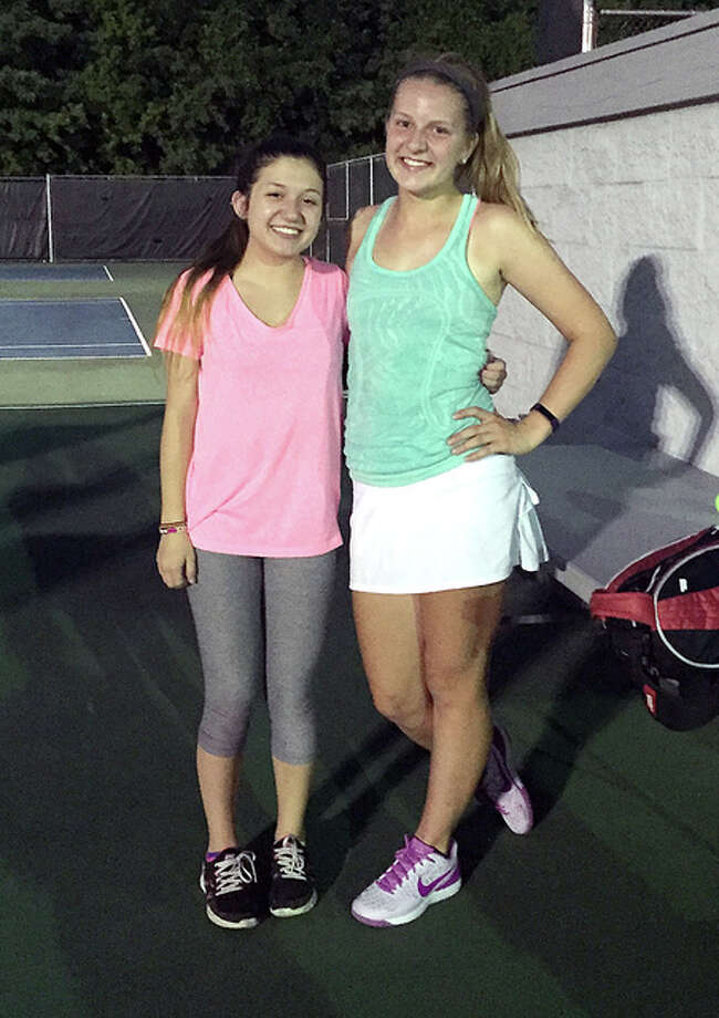 Shannon Willis, left, and Abby Fischer won the Alton Closed Tennis Tourney Women's Open title Thursday night.
