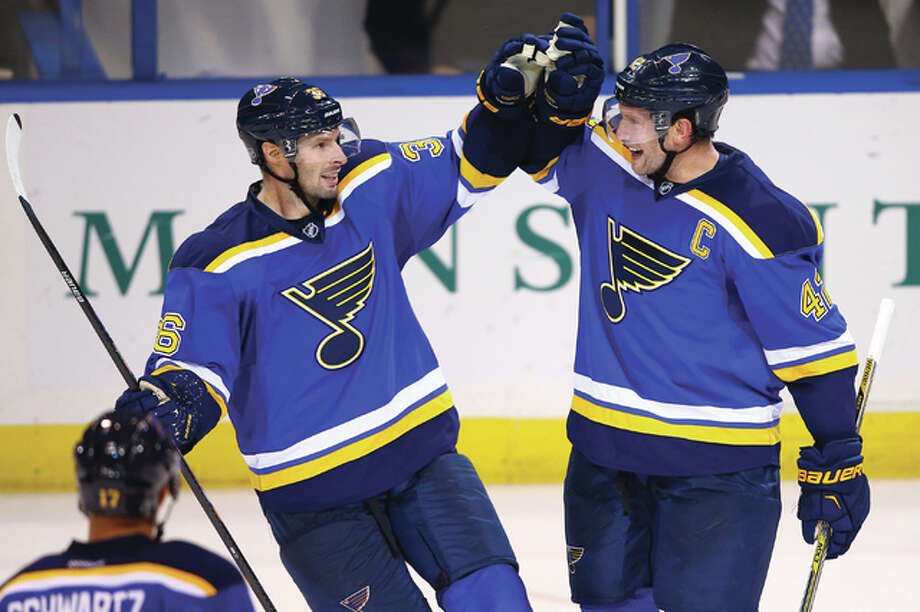The St. Louis Blues lost free agents Troy Brouwer (left) to Calgary and David Backes (right) to Boston Friday. The two are shown celebrating a goal last season. Photo: Billy Hurst File Photo | For The Telegraph