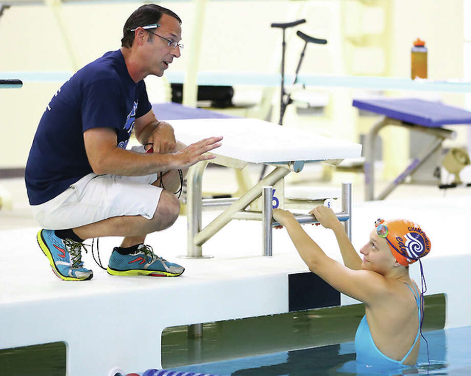 Edwardsville YMCA Breakers coach Bob Rettle and swimmer Bailey Grinter at a training session last week at the Chuck Fruit Aquatic Center. Bailey will swim her second event of the US Olympic Swim Trials Saturday in Omaha. Photo: Billy Hurst File Photo | For The Telegraph
