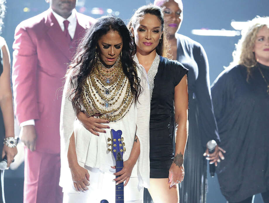 Matt Sayles | Invision (AP) Sheila E. (left) and Mayte Garcia stand on stage following a performance in tribute to Prince at the BET Awards in Los Angeles on Sunday.