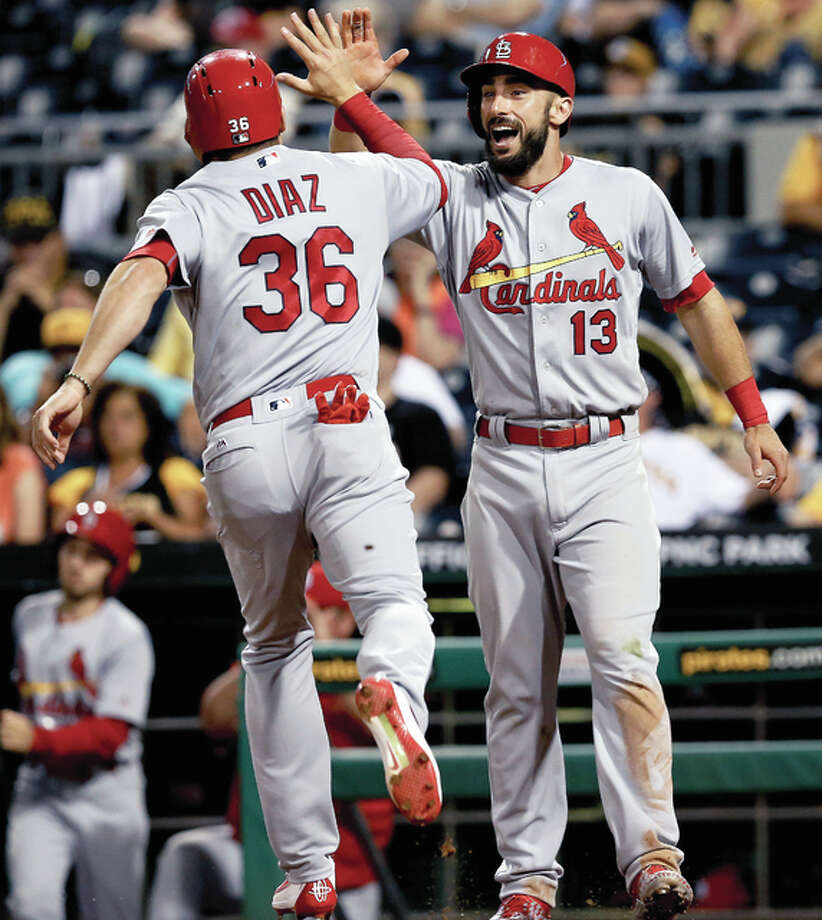 The Cardinals' Aledmys Diaz (36) has replaced teammate Matt Carpenter on the National All-Star Team after Carpenter suffered a strained right oblique n Wednesday's night's loss to the Pirates. Above, Carpenter greets Diaz (36) after they each had scored in a game last month in Pittsburgh. Photo: AP File Photo