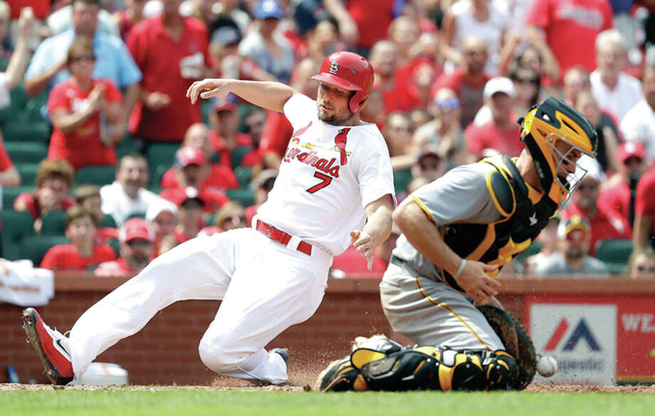 The Cardinals' Matt Holliday, left, scores past Pirates catcher Eric Fryer in the sixth inning Thursday in St. Louis. The play was first ruled a double by Cardinals' Stephen Piscotty, but was changed to a three-run home run after review. Photo: Jeff Roberson | AP Photo