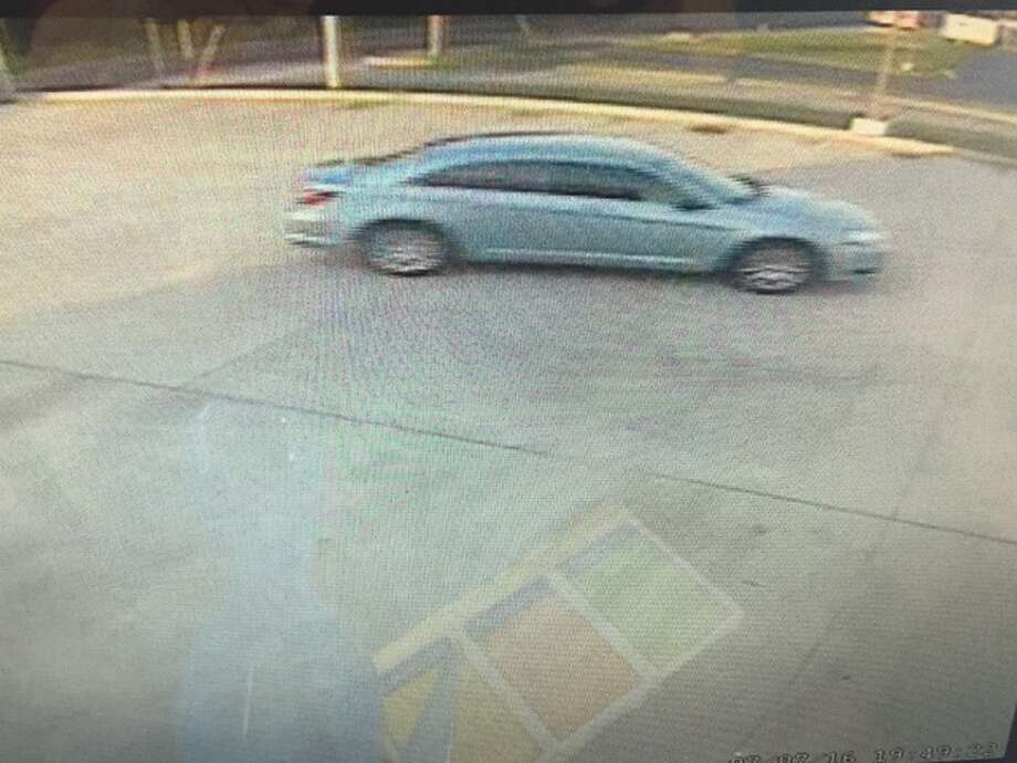 Surveillance footage captured the silver passenger car used to get away following the alleged armed robbery Thursday.