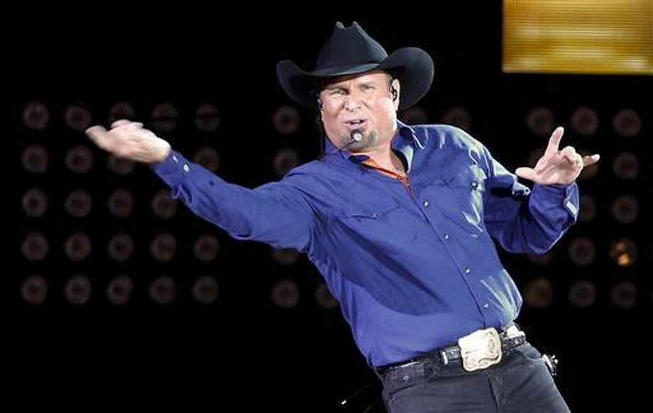 "Garth Brooks sings ""Ain't Going Down"" for his opening song during a performance at Yankee Stadium, Friday, July 8, 2016, in New York."