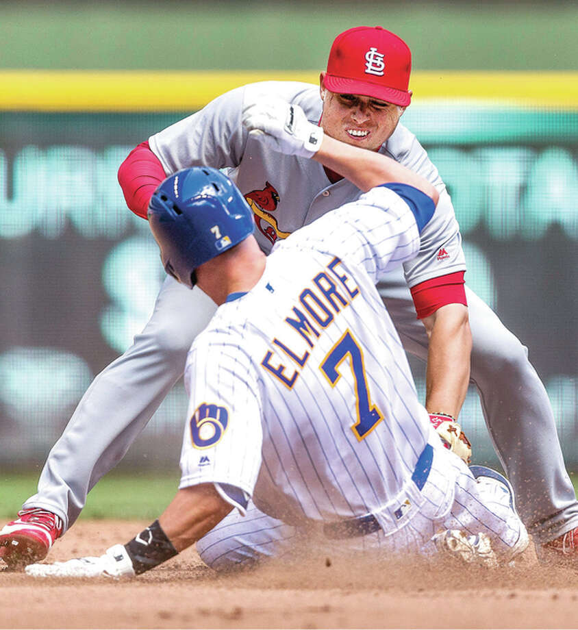The Brewers' Jake Elmore is tagged out attempting to stealing second by the Cardinals' Aledmys Diaz in the fourth inning of Saturday's game in Milwaukee. Photo: Tom Lynn | AP Photo