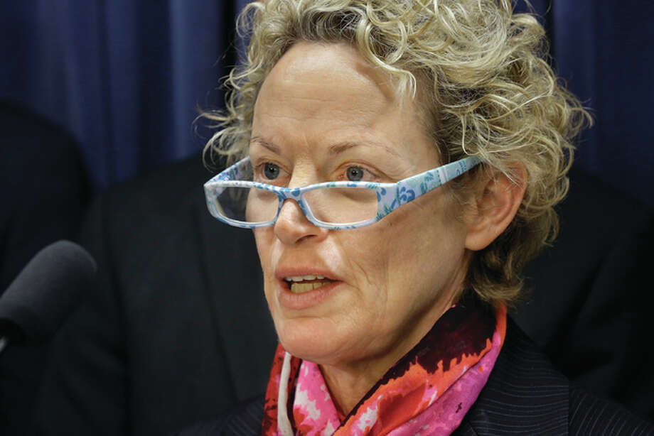 In this Feb. 19, 2015, file photo, Illinois Rep. Elaine Nekritz, D-Northbrook, speaks to reporters during a news conference at the Illinois State Capitol in Springfield, Ill. Getting a DUI in Illinois can be more costly in one county compared to another, with court fines and fees varying widely from one place to another, according to a recent report that recommends lawmakers overhaul what's become a convoluted system. The report found that court fees have become so bloated over the years with surcharges to pay for various programs unrelated to the actual case, like law libraries and roadside memorials. Photo: (AP Photo/Seth Perlman)