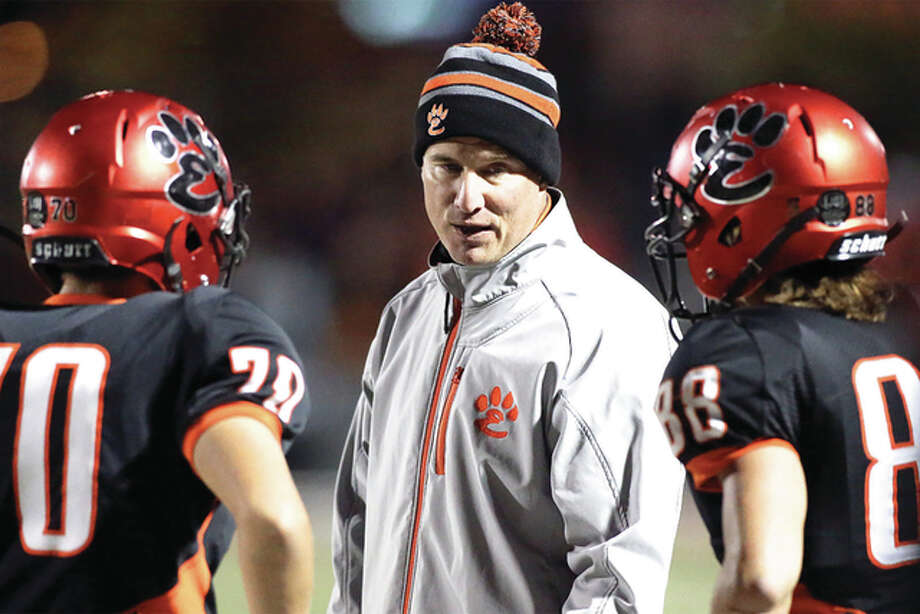 Garrett Burns (70) Coach Matt Martin, and Nathan Kolesa (88) Photo: Scott Kane File Photo | For The Telegraph