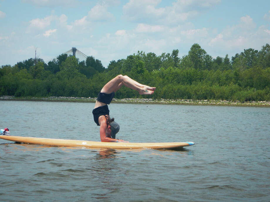 For its third season, River Bend Yoga is offering stand-up paddle board yoga classes from 12 to 1:30 p.m. every Saturday, weather permitting, through Sept. 24. Instructor/co-owner Janet Keffer does different yoga poses on a paddle board.