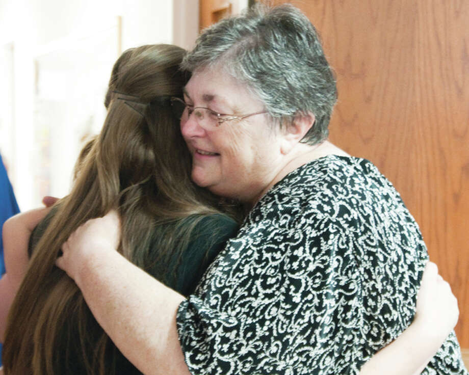 Rev. Pam Laing, of United Presbyterian Church in Wood River, hugs a guest during a Sunday reception who wished her well after Laing's last service at the church Sunday. Laing served 19 years as the church's pastor. She is starting a new position in Effingham as the interim/transitional pastor of First Presbyterian Church. Photo: Dan Cruz For The Telegraph