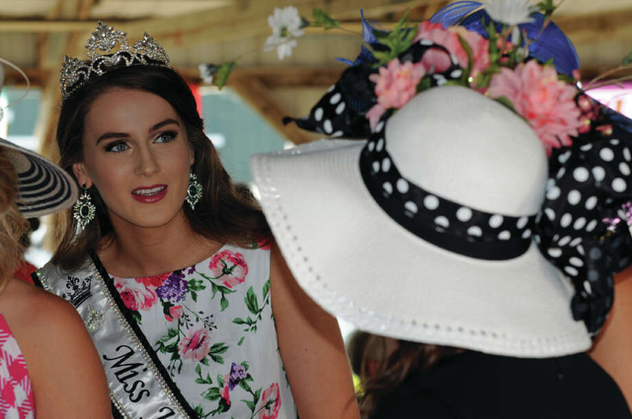 Current Jersey County Fair Queen Morgan Moore examines entrants in the Sunday Go To Meetin' Hat Parade at the Jersey County Fair Sunday evening. Photo: David Blanchette|For The Telegraph
