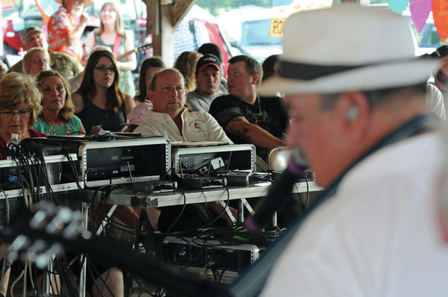 The crowd listens to Bo Schultz of the Fieldon Praise Band at the Jersey County Fair Christian Music Celebration Sunday evening. Photo: David Blanchette|For The Telegraph
