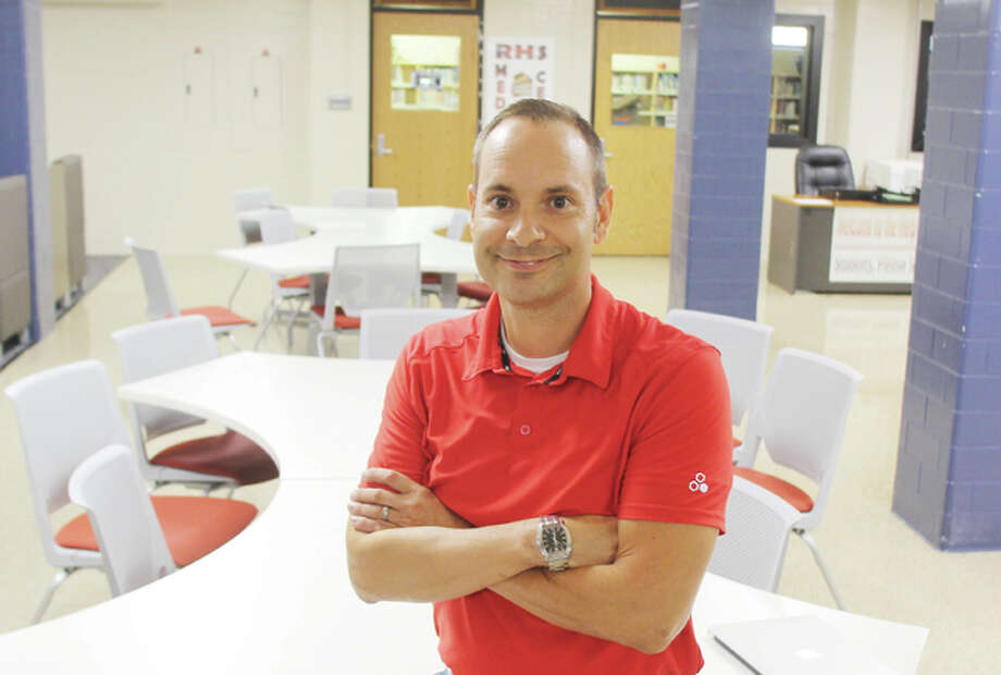 Scott Cousins/The Telegraph New Roxana High School Principal Jason Dandurand has been spending the last week or so meeting people and getting to know the building. He started July 1 after spending four years at principal at Columbia High School in Monroe County.
