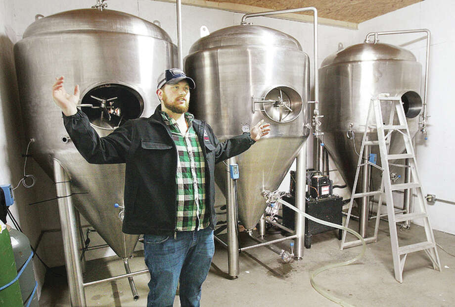 In this November 2015 photo, Richard Blevens, one of the owners of Templar Brewing, talks about the brewery's operation located in the warehouse portion of the old Milton School building on Milton Road in Alton. Photo: John Badman | The Telegraph