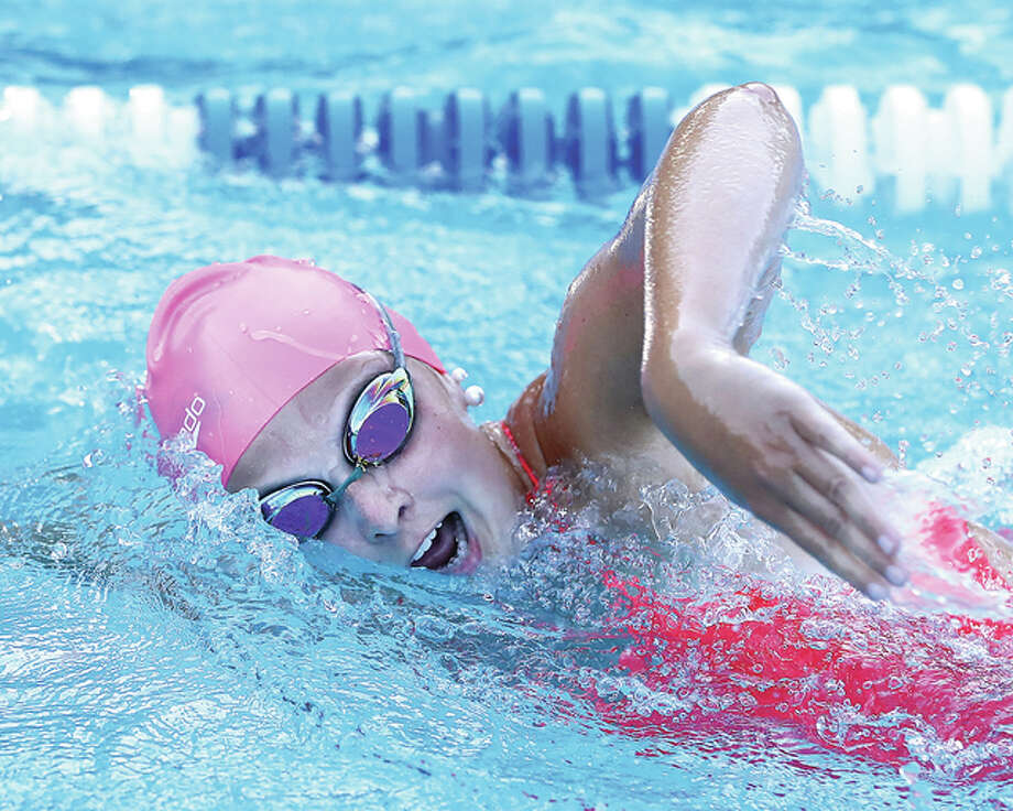 Karoline Lauritzen of Summers Port swims the freestyle during action in Tuesday night's win over Paddlers of Granite City. Lauritzen won the 15-18 girls 100-yard freestyle. Photo: Billy Hurst | For The Telegraph