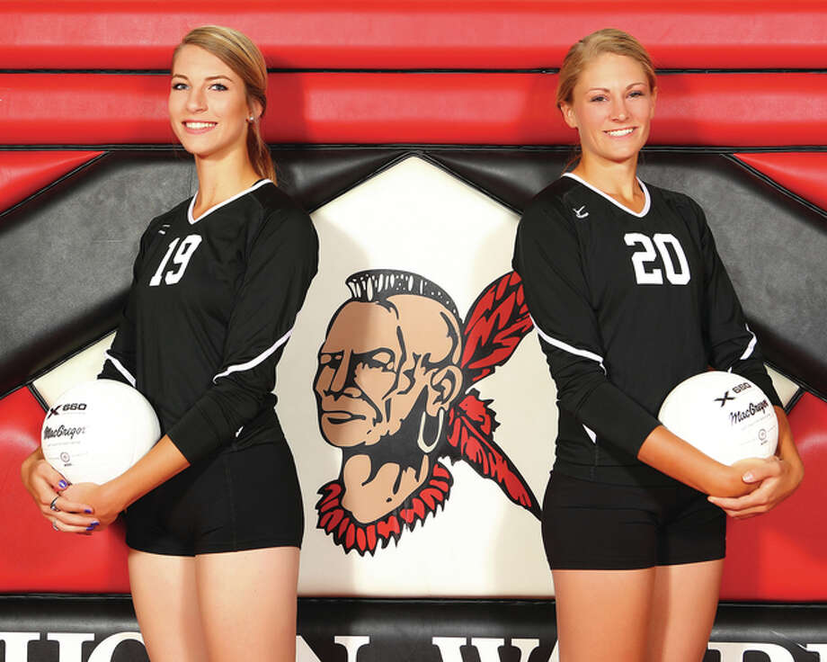 Calhoun junior Grace Baalman (left) and Emma Baalman led the Warriors to a 31-3 record and a Class 1A regional championship to share recognition as 2015 Telegraph Small-Schools Volleyball Players of the Year. Photo: Billy Hurst / For The Telegraph