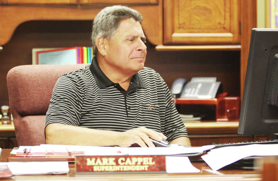 Interim Alton School District Superintendent Mark Cappel goes over some paperwork Thursday. Cappel, who had retired from the district the year before, was recently appointed interim after former superintendent Kenneth Spells took a job in South Bend, Indiana.