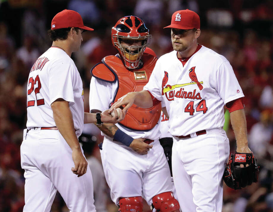 Cardinals relief pitcher Trevor Rosenthal (44) is removed by manager Mike Matheny (left) as catcher Yadier Molina watches during the seventh inning against the Miami Marlins on Friday night at Busch Stadium. Photo: Associated Press
