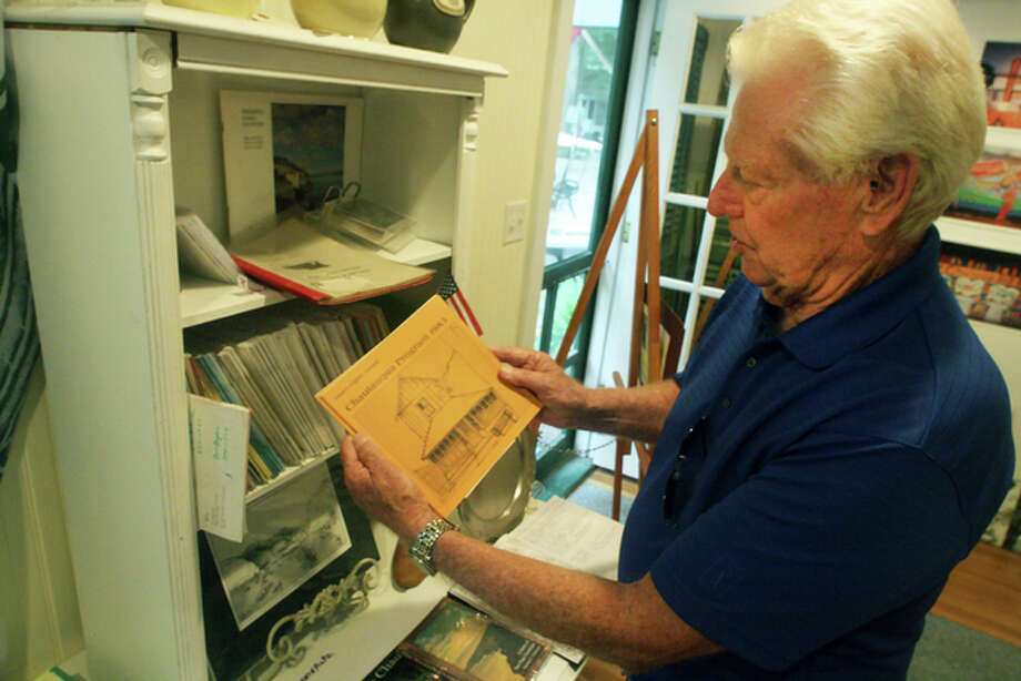 Chautauqua resident Don Bryant examines an annual guide the gated community produces, complete with a directory of all residents.