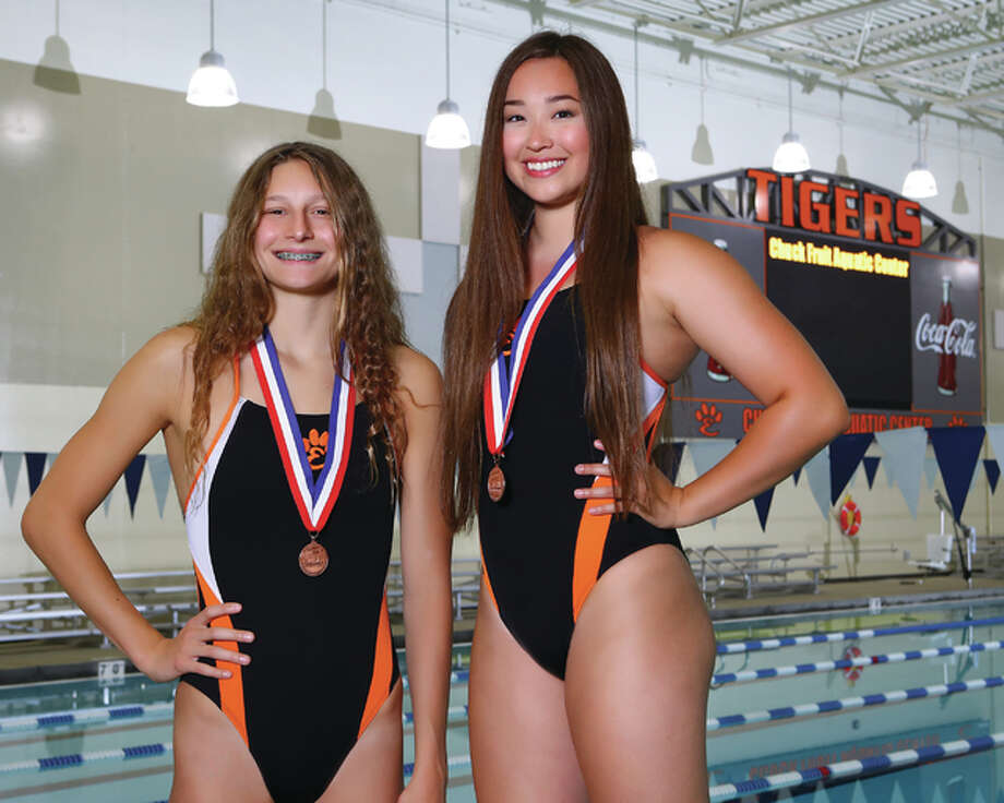 Edwardsville's Bailey Grinter (left) and Kate May each earned three IHSA State Finals berths last season and each brought home a state medal for the Tigers. They are the Telegraph Swimmers of the Year. May is a Purdue University recruit and Grinter will be a senior at EHS this fall. Photo: Billy Hurst | For The Telegraph