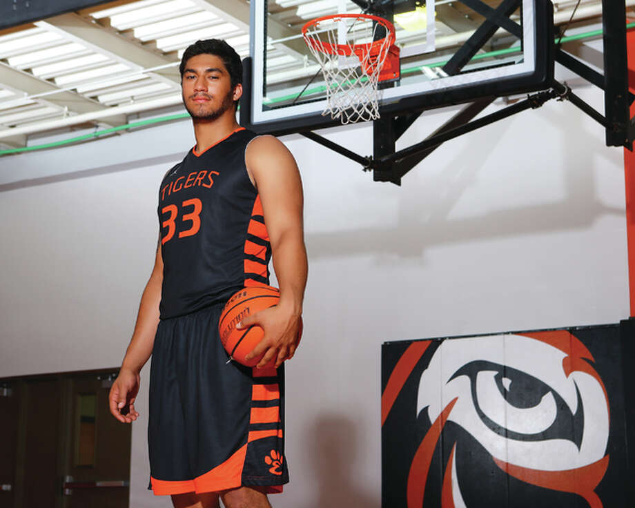 Edwardsville junior AJ Epenesa is the 2016 Telegraph Large-School Boys Basketball Player of the Year. An All-America in both football and track, Epenesa became the first boys basketball player in Tigers history to earn Associated Press All-State as a junior. Photo: Billy Hurst / For The Telegraph