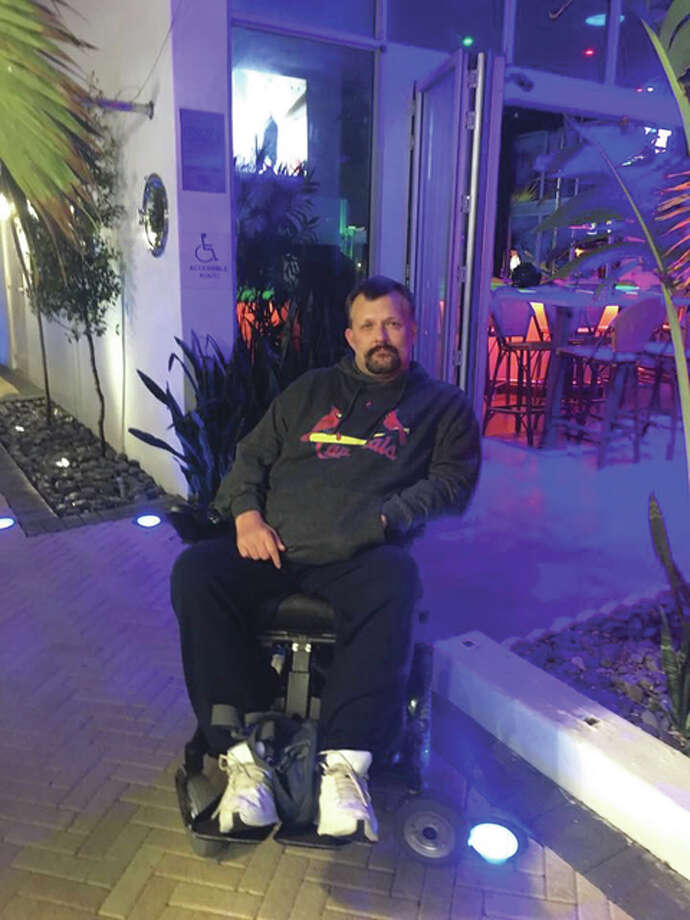 """Dad On Wheels"" author Leslie A. Johnson, left paralyzed after a car crash from the neck down at the age of 16, wrote a story based on his experience when his two sons asked ""Daddy, why can't you stand?"" Photo: For The Telegraph"