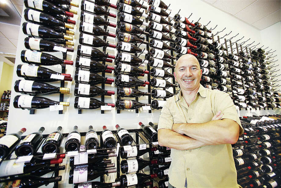 Dr. Walter Osika, a practicing dentist who attended Southern Illinois University School of Dental Medicine in Upper Alton, now also is a wine retailer as owner of Bin 51 Wine and Spirits, 200 S. Buchanan St., Edwardsville.