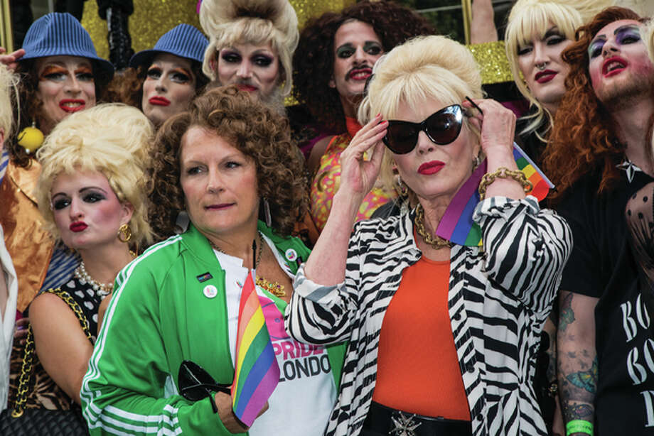 "This June 25 file photo of British actresses Jennifer Saunders, left, and Joanna Lumley as they pose for photographers during a photo call to promote the film ""Absolutely Fabulous,"" during the annual Gay Pride parade in London. Both are in character, Saunders, as Edina Monsoon, and Lumley, as Patsy Stone, of ""Absolutely Fabulous: The Movie."" Photo: (Photo By Vianney Le Caer/Invision/AP, File)"