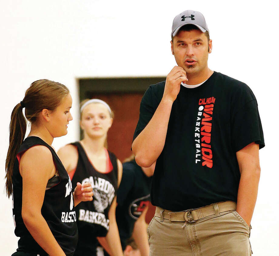 Calhoun coach Aaron Baalman (right) talks with Madison Lehr during a 2015 summer game in Bethalto. A repeat choice as coach of the year, Baalman led the Warriors to a Class 1A state championship in 2016 after a state runner-up finish in 2015. Photo: Billy Hurst | For The Telegraph
