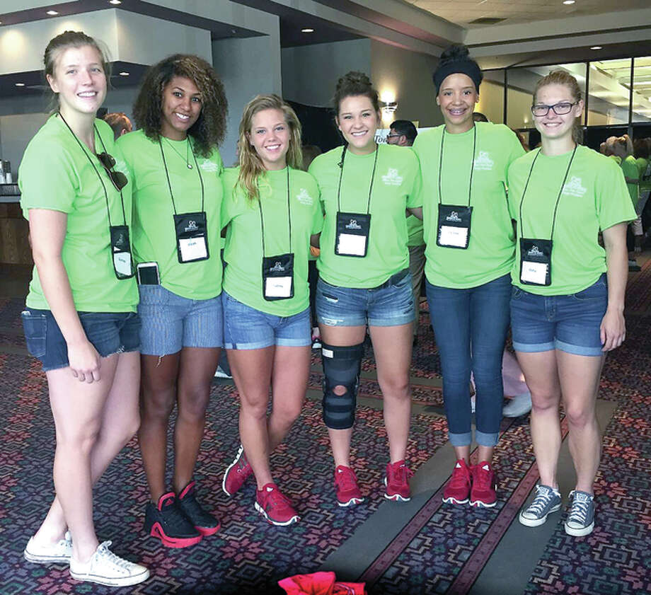 Members of the SIU Edwardsvile women's basketball team, above, recently volunteered at the Illinois State Dental Society Foundation's fourth Mission of Mercy.