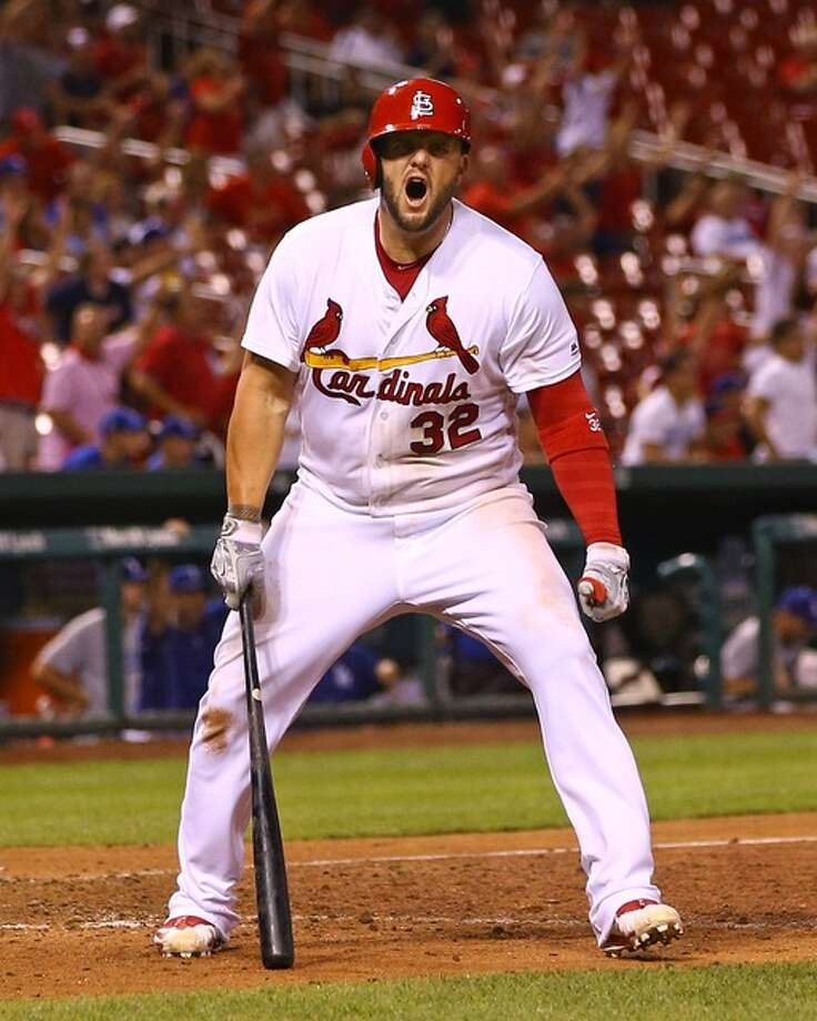 The Cardinals' Matt Adams celebrates after blasting a walk-off home run to win Friday night's game against the Los Angeles Dodgers in the bottom of the 16th inning at Busch Stadium. Photo: Billy Hurst / For The Telegraph
