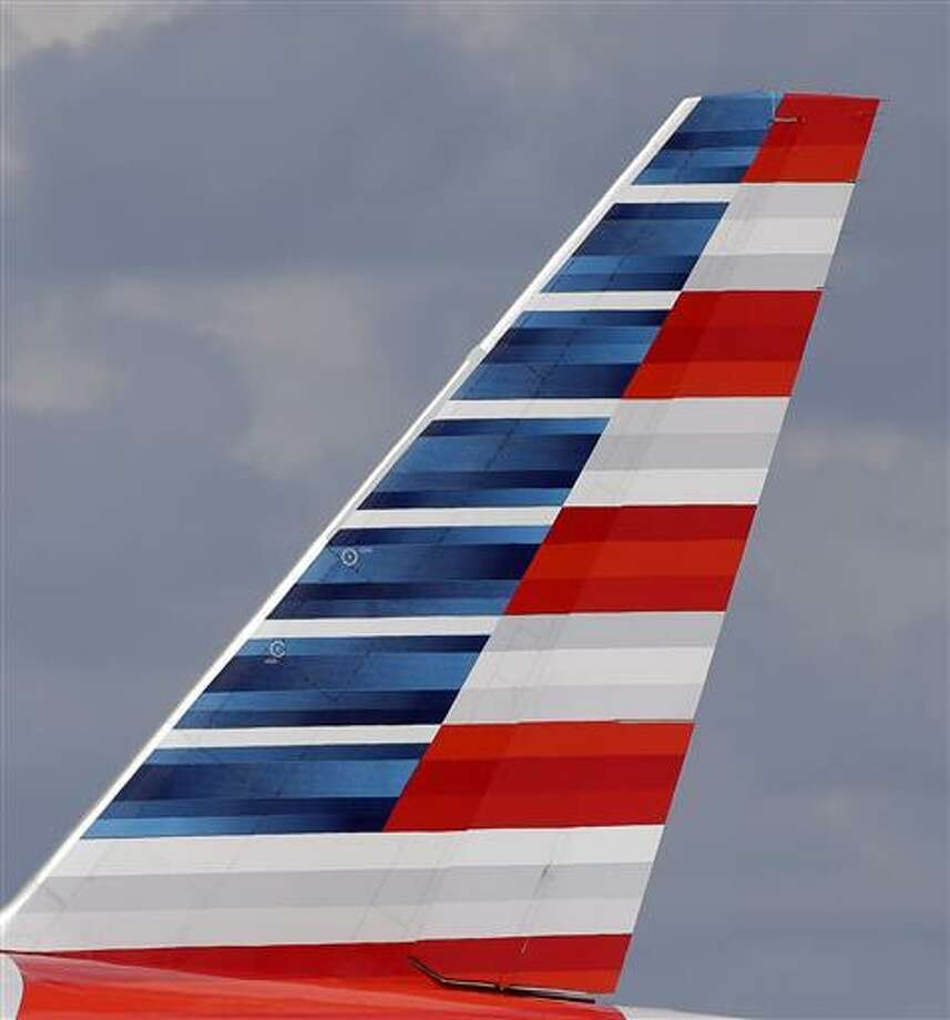 This Friday, June 3 photo shows the tail of an American Airlines passenger jet at Miami International Airport in Miami. On Friday American reports financial results.