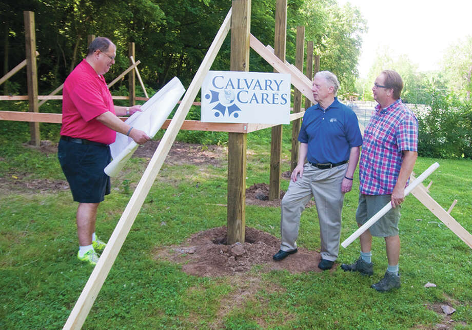 Greg Gelzinnis, Chaplain Mark Lane and Alton Middle School science teacher Sigurd Uttgaard talk about finalizing the pole barn-type of facility just north of the Rock Springs Park tennis courts that will be of multi-use for various types of classes during the school year. The target date to have this project complete is Aug. 6.