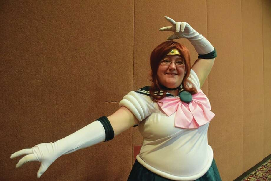 "Cosplayer Jessi Schoon, as popular '90s anime character Sailor Jupiter from ""Sailor Moon,"" attended NatsuCon Sunday in Collinsville. Schoon said conventions like NatsuCon help build her confidence. Photo: Katelyn Petrin