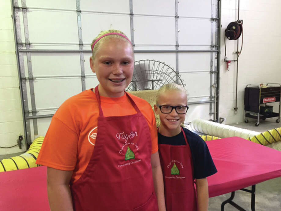 "Taylor Freer, 12, and her sister Lily Freer, 9, with the help of their family, began ""Christmas in July"" eight years ago. Christmas in July is an annual fundraising jump-start event for the Riverbend's Community Christmas that provides generously for families in need at Christmastime."