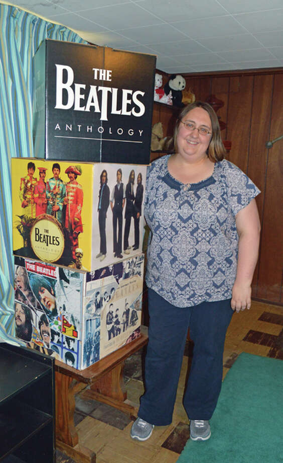 "Longtime Beatles fan, Sara Schmidt, recently released the book, ""Happiness is Seeing the Beatles: Beatlemania in St. Louis,"" which focuses specifically on the group's 1966 St. Louis appearance and Beatles facts relating to St. Louis from 1963 to 2015. Photo: Vicki Bennington/For The Telegraph"