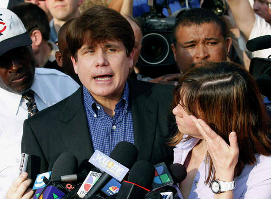 "In this March 14, 2012, file photo, former Illinois Gov. Rod Blagojevich speaks to the media outside his home in Chicago as his wife, Patti, wipes away tears a day before he was to report to a prison after his conviction on corruption charges. On Monday, July 25, 2016, federal prosecutors said statements Blagojevich has made prove he isn't ""deserving of leniency."" A resentencing hearing is scheduled next month for Blagojevich, who is hoping a federal judge will give him a five-year sentence instead of his original 14 years."