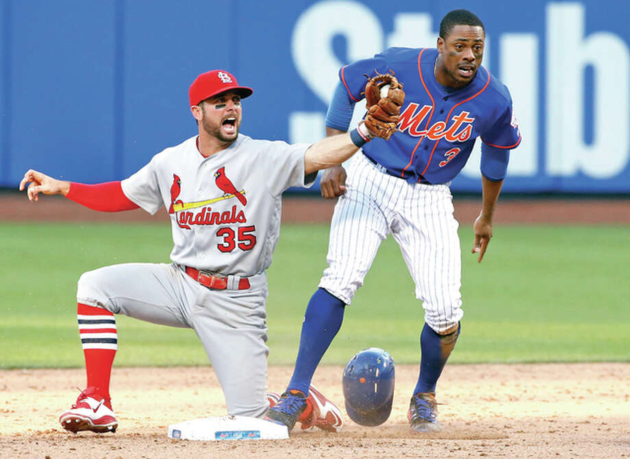 Cardinals second baseman Greg Garcia (35) reacts after tagging out New York Mets' Curtis Granderson (3) on a double play after Yoenis Cespedes flied out to center field in the ninth inning of the first game of a doubleheader Tuesday in New York. The Cardinals defeated the Mets 3-2. Photo: Kathy Willens | AP Photo