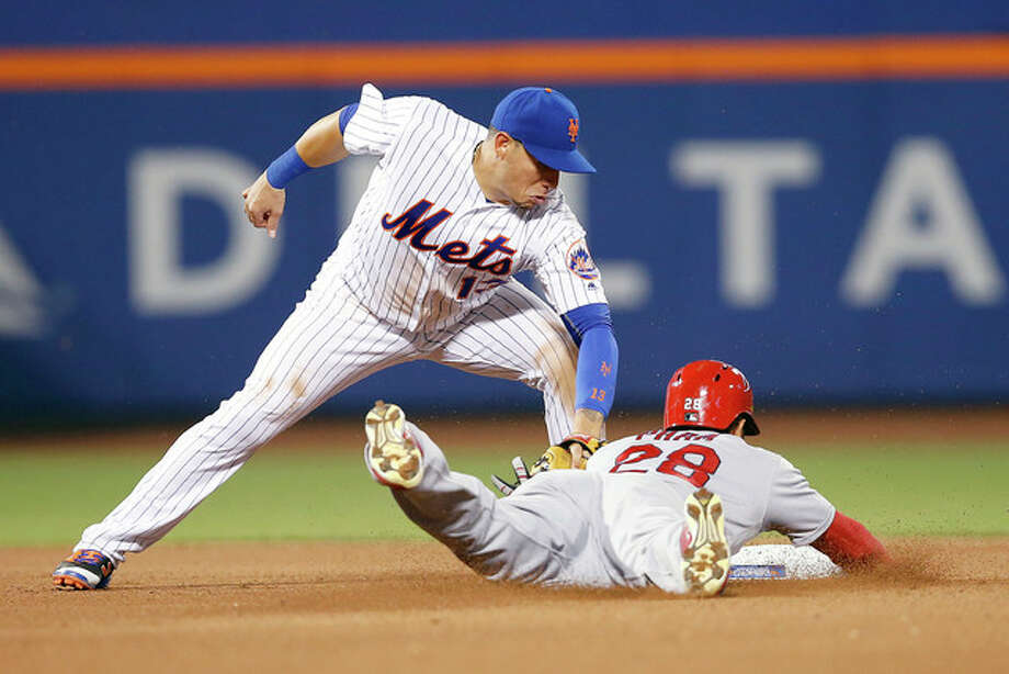 New York Mets shortstop Asdrubal Cabrera (13) tags out the Cardinals' Tommy Pham on an attempted steal during the seventh inning Wednesday in New York. Photo: Kathy Willens | AP Photo