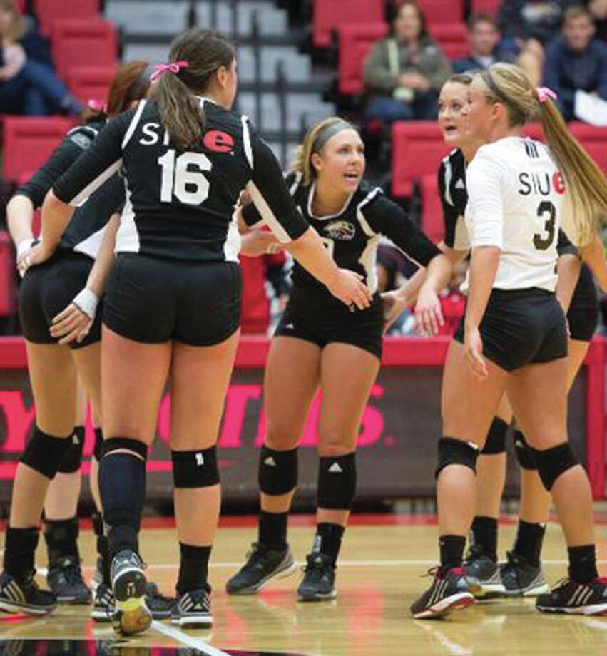 Members of the SIUE Cougars volleyball team huddle up before a match last season at Vadalabene Center in Edwardsville. SIUE athletics was honored for its academic performance by the Ohio Valley Conference. Photo: SIUE Athletics