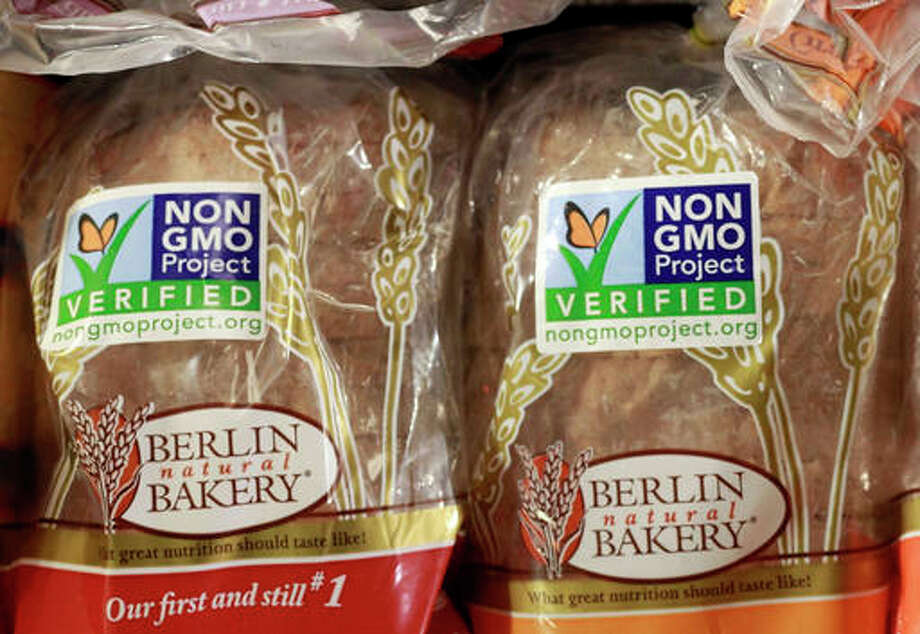 In this file photo. products labeled with Non Genetically Modified Organism (GMO) are sold at the Lassens Natural Foods & Vitamins store in Los Feliz district of Los Angeles. President Barack Obama on Friday, has signed into law a bill that will require labeling of genetically modified ingredients for the first time. The legislation will require most food packages to carry a text label, a symbol or an electronic code readable by smartphone that indicates whether the food contains genetically modified ingredients, or GMOs.