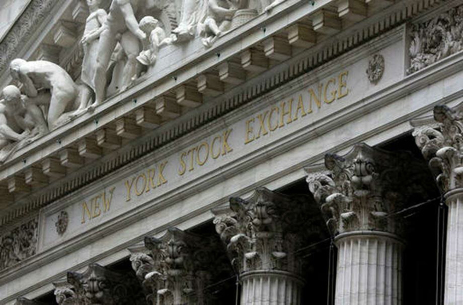 This file photo shows the facade of the New York Stock Exchange. Stock markets around the world are ending the week on a flat note after the Bank of Japan disappointed investors Friday, with a smaller than anticipated stimulus. However, the yen surged following Friday's decision.