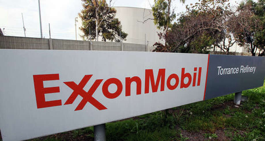 This file photo shows the sign for the Exxon Mobil Torrance Refinery in Torrance, Calif. Exxon Mobile Corp. reports financial results Friday.