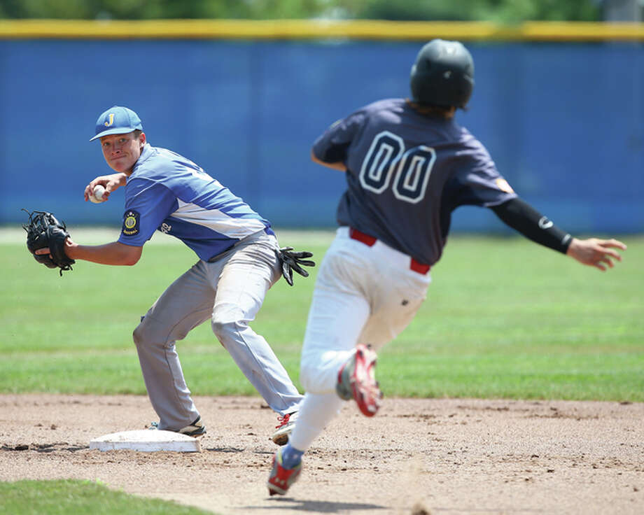 Jerseyville's Chace Tallman (left) makes the pivot and turns a double play while Quincy's JJ Bryant approaches second base during Thursday's action at the Illinois State American Legion Tournament at Ken Schell Field in Jerseyville. Photo: Billy Hurst / For The Telegraph