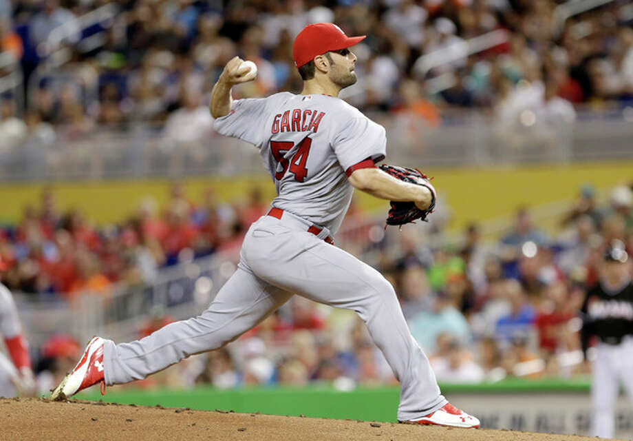 Cardinals pitcher Jaime Garcia works against the Marlins during the first inning Saturday night in Miami. Photo: Associated Press