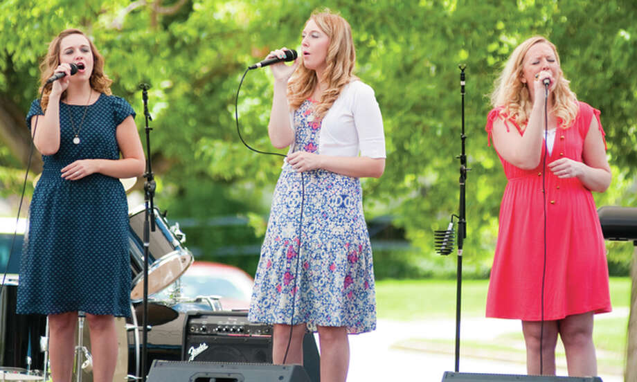 "The Gibson Girls, from Jerseyville, were one of 10 musical acts to perform Saturday at the second annual Pietown Gospel Musicfest. The trio ended their musical selection by singing one of their newer songs, ""I Surrender All."" Photo: Dan Cruz