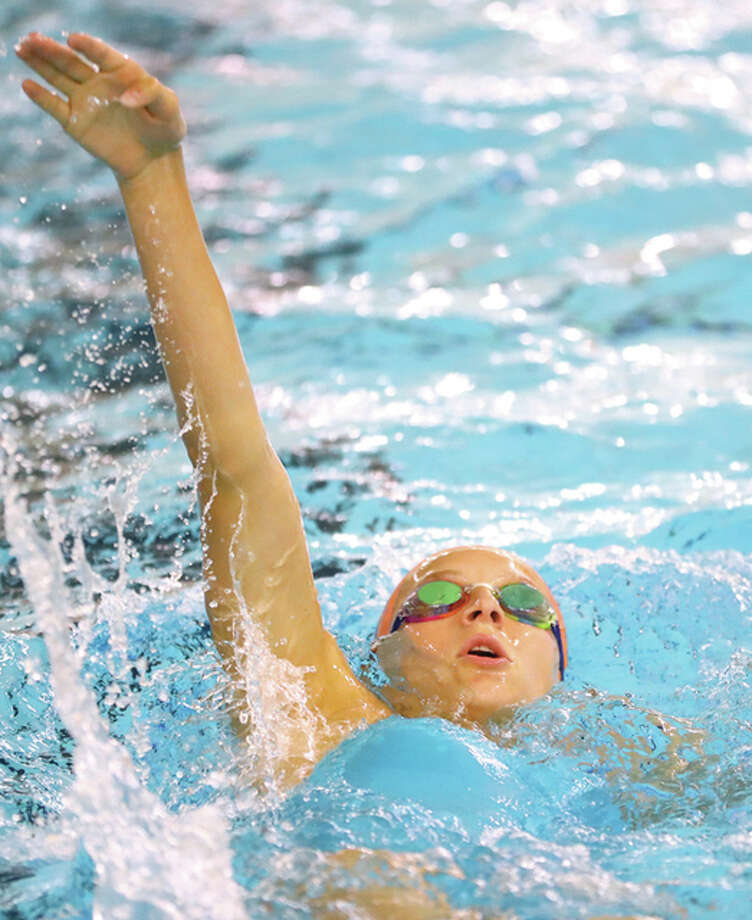Bailey Grinter of the Edwardsville Breakers won the national championship in the 50-meter backstroke Sunday nigh at the YMCA Long course Championships at the Indiana Natatorium in Indianapolis.
