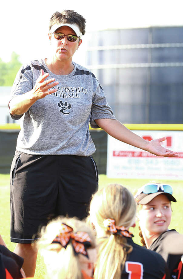 Edwardsville head coach Lori Blade talks with her players at the end of the Class 4A Normal West sectional semifinal game against Belleville East, Tuesday in Collinsville. Edwardsville won the game 10-2. Credit: Billy Hurst - For the Telegraph Photo: Billy Hurst / Telegraph File Photo