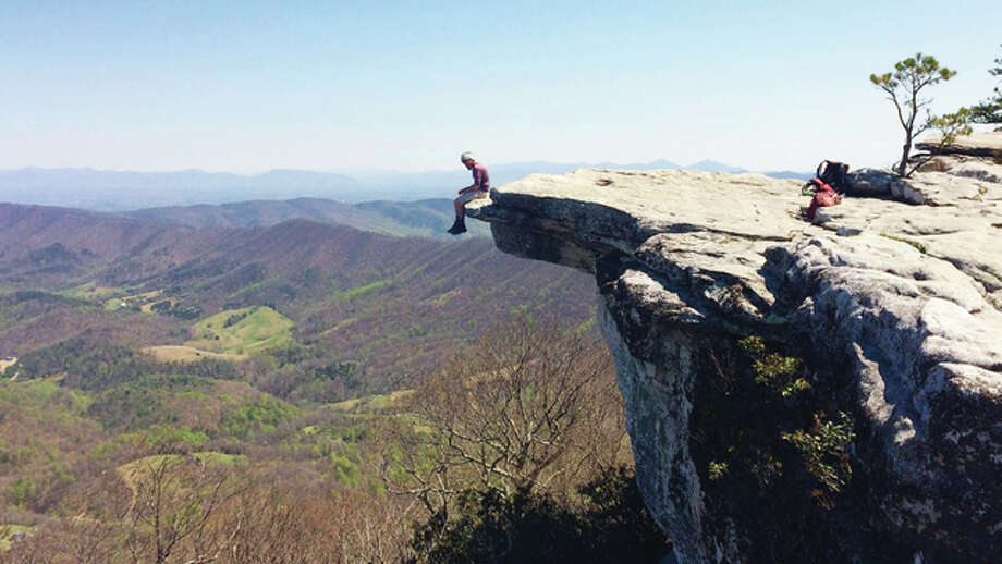 Alton resident Aaron Winenger hangs his feet off of McAfee Knob, a rock outcropping in Virginia that is one of the most well-known features of the Appalachian Trail. Photo: For The Telegraph